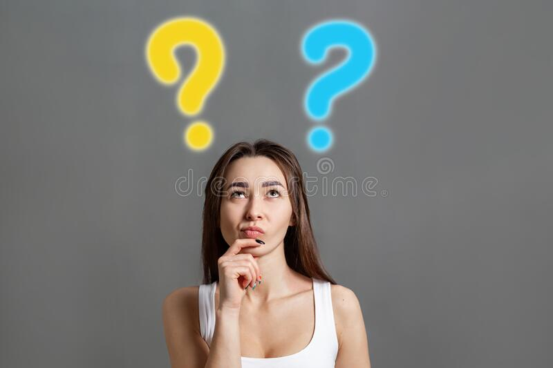 The concept of searching for ideas and information. Portrait of a brooding young Caucasian woman looking up at question marks. vector illustration