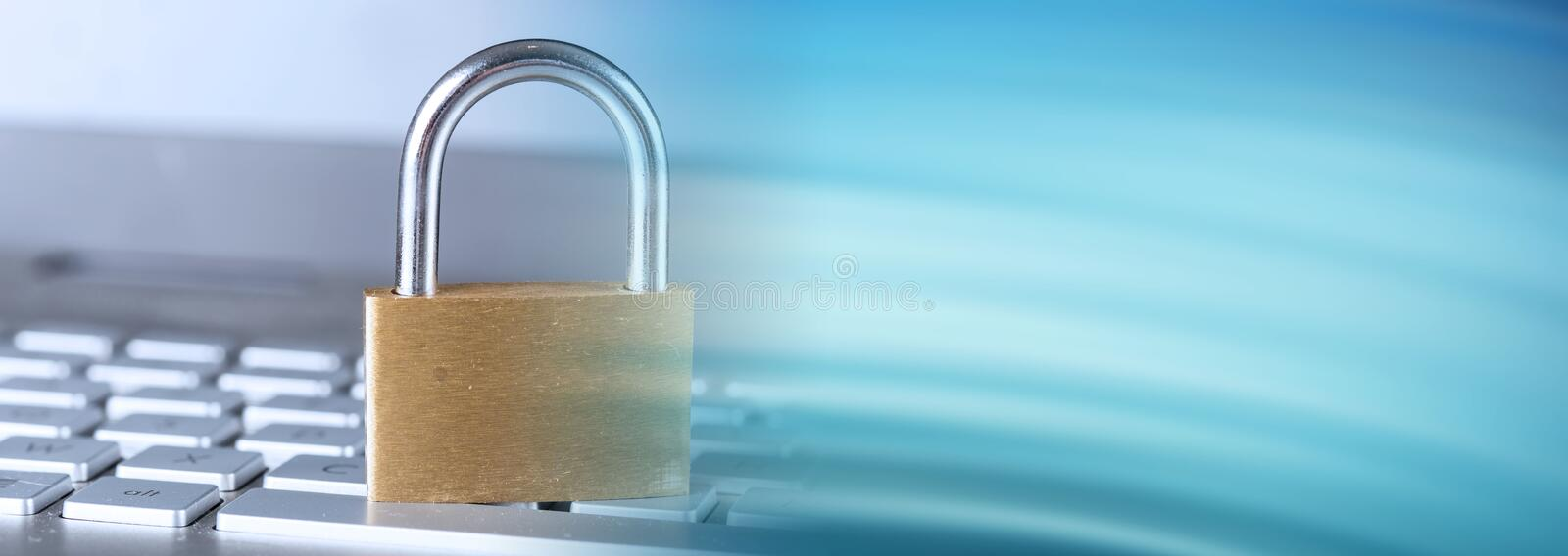 Concept of it security; panoramic banner. Padlock on computer keyboard; panoramic banner stock photography