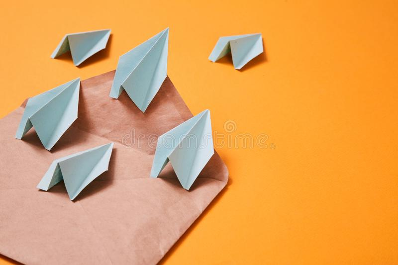 Concept for sending e-mails and e-commerce business. Email marketing. Paper planes flying out of the envelope.  stock photo