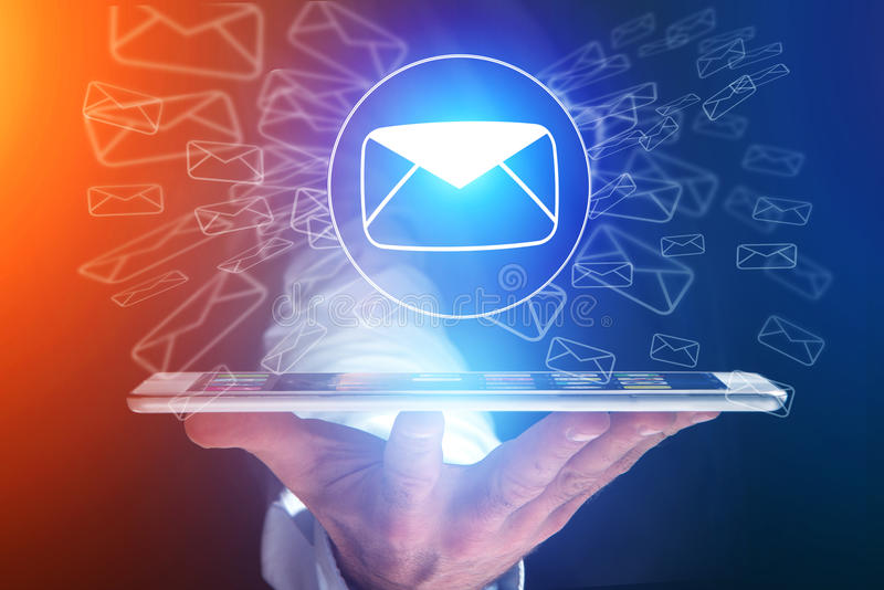 Concept of sending email on smartphone interface with message icon around stock image