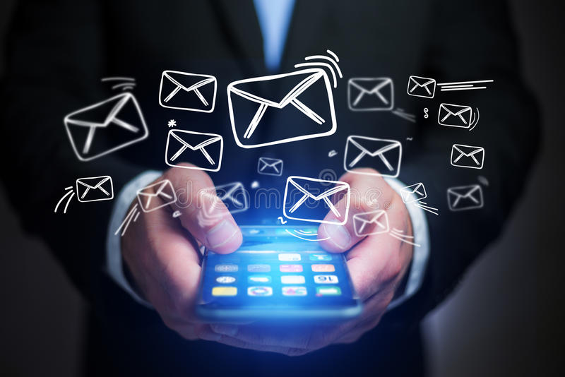 Concept of sending email on smartphone interface with message icon around. Concept view of sending email on smartphone interface with message icon around royalty free stock photo