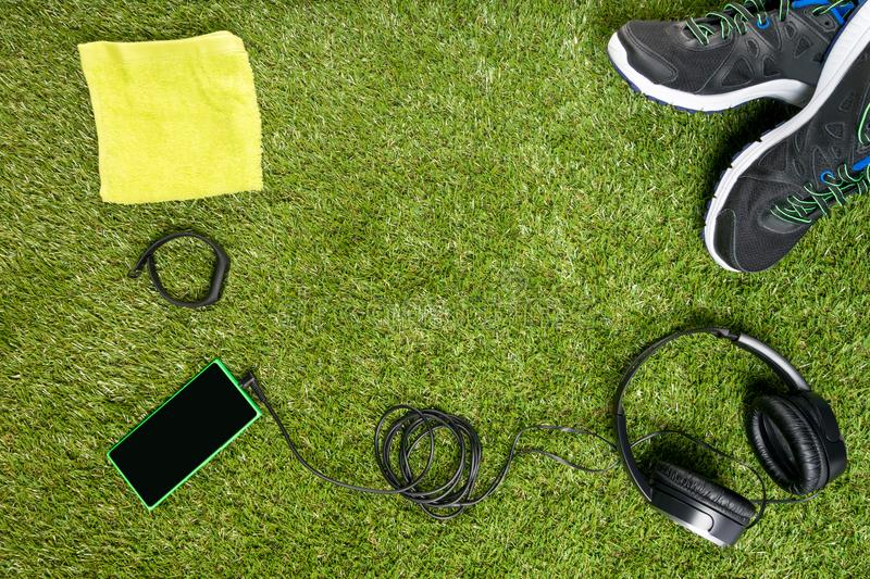 Concept of a set for sport on a background of a green lawn stock image
