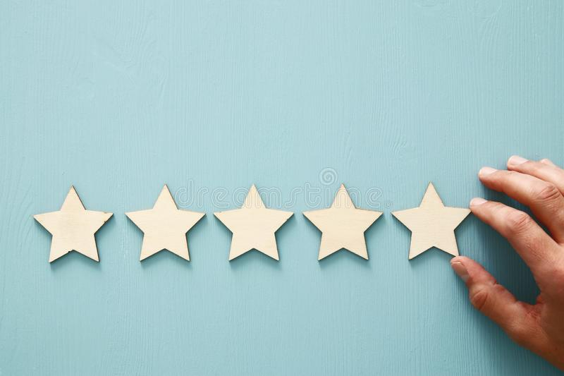Concept of setting a five star goal. increase rating or ranking, evaluation and classification idea. Concept of setting a five star goal. increase rating or stock photo