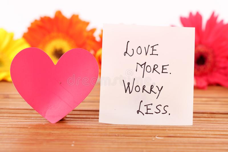 Love more worry lesss stock images