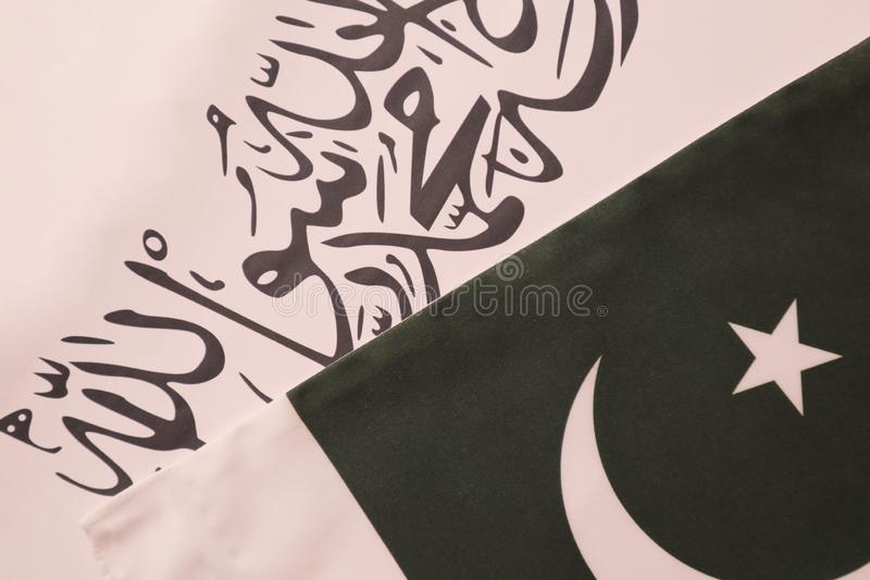 Concept showing of Pakistan and Taliban deal preocess showing with flags. Concept showing of Pakistan and Taliban deal preocess showing with flags royalty free stock photography