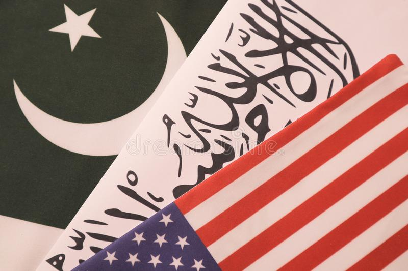 Concept showing of US, Pakistan and Taliban deal preocess showing with flags. Concept showing of US, Pakistan and Taliban deal preocess showing with flags royalty free stock photography
