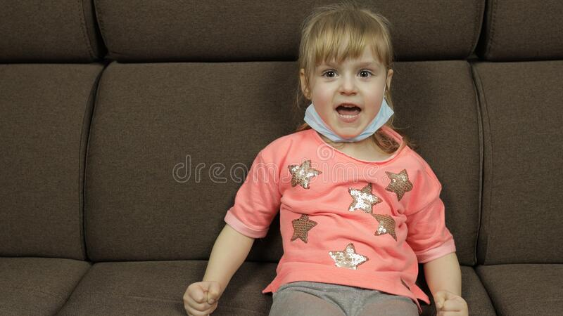 Concept of sick little girl wearing a medical mask. Quarantine. Coronavirus. Prevention of COVID-19 Coronavirus Infection. Concept of sick little girl wearing royalty free stock photo