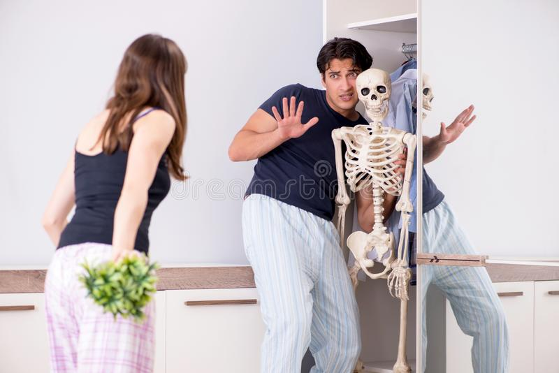The concept of skeleton in the cupboard or closet royalty free stock photography