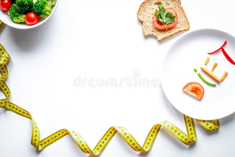 Concept slimming diet fresh vegetables on white background top v royalty free stock image