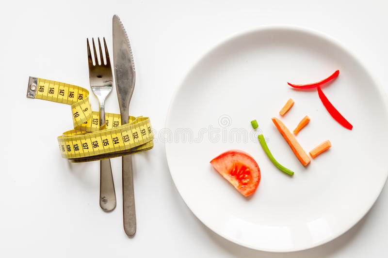 Concept slimming diet fresh vegetables on white background top view.  stock photos