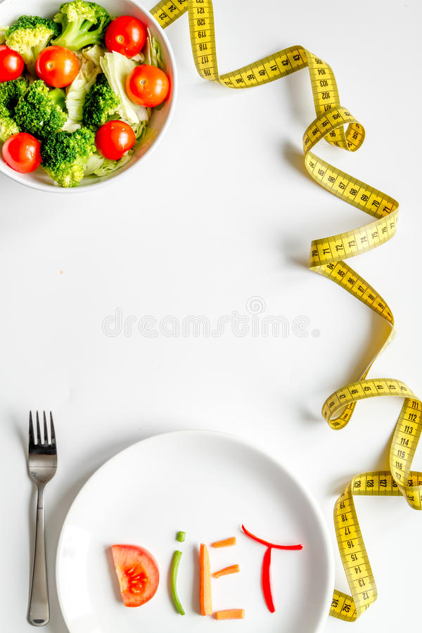 Concept slimming diet fresh vegetables on white background top view.  royalty free stock photography