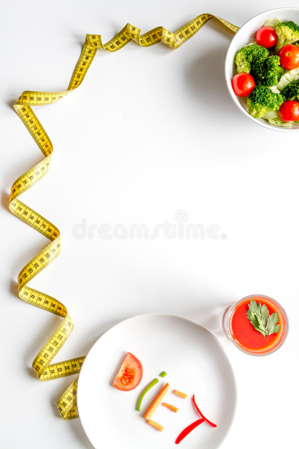 Concept slimming diet fresh vegetables on white background top view.  stock image