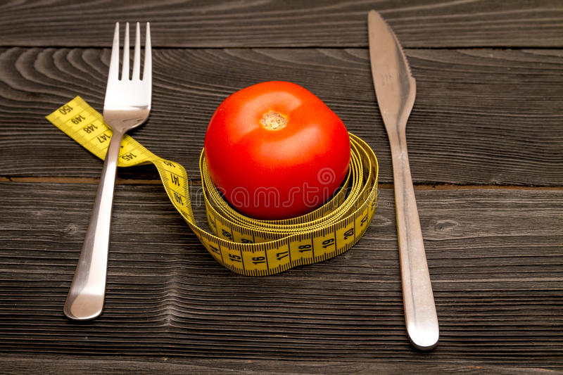 Concept slimming diet fresh vegetables on wooden background.  stock images