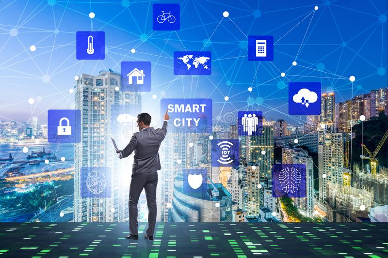 The concept of smart city with businessman pressing buttons royalty free stock photos