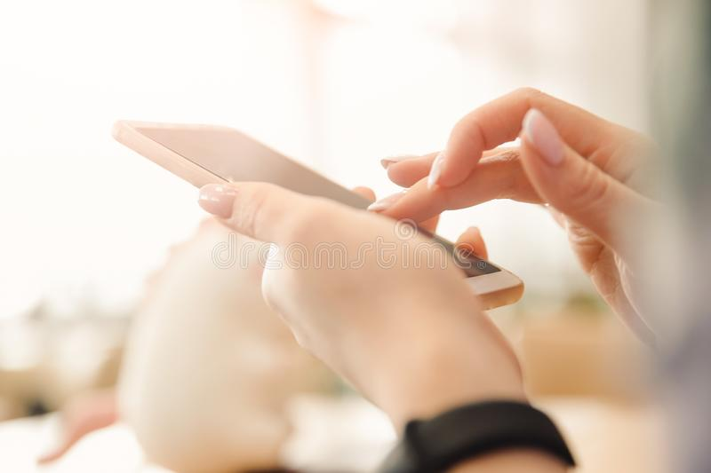 Concept of social communication in Internet chat on phone. Hands girl browses video dating stock photos