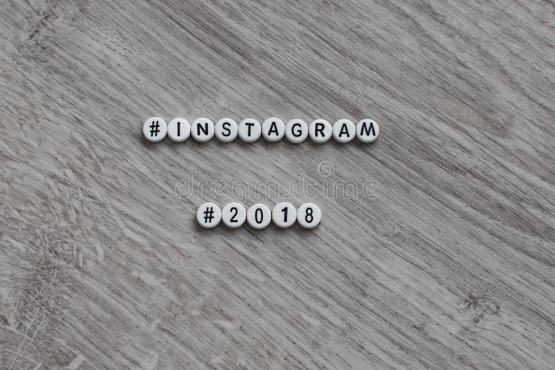 The concept of a social network of instagram in the form of separate circular letters of the alphabet on a wooden background. Insc. Ription instagram 2018 royalty free stock photos