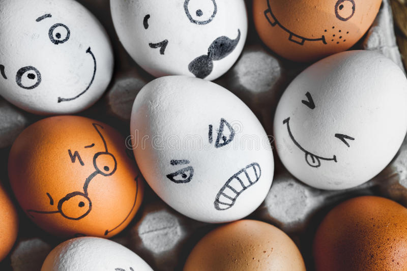 Concept social networks communication and emotions - eggs angry. In box stock images