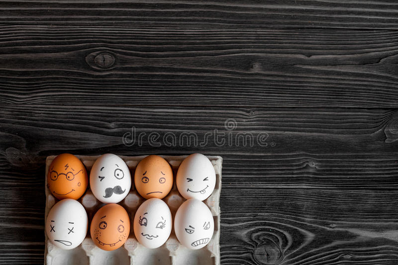 Concept social networks communication and emotions - eggs. On dark wooden background royalty free stock photos