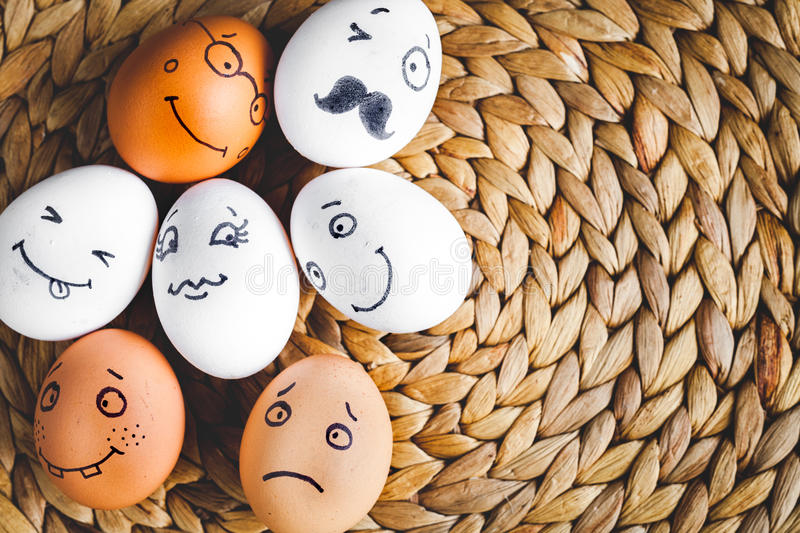 Concept social networks communication and emotions - eggs. On mat top view royalty free stock images