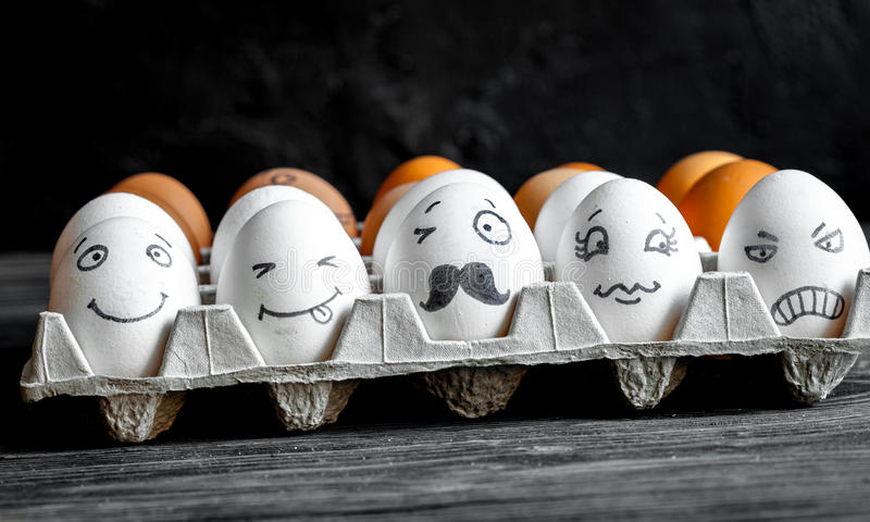 Concept social networks communication and emotions - eggs wink royalty free stock photos