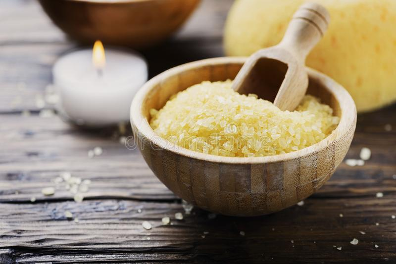 Concept of spa therapy and wellness with yellow salt and candles. Selective focus stock photography