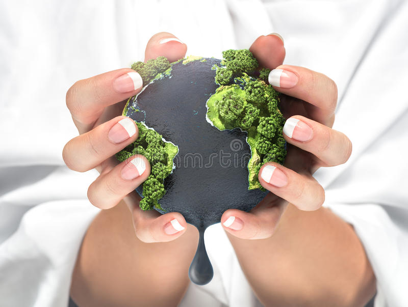 Concept of squeezing the resources of the planet. royalty free stock photos