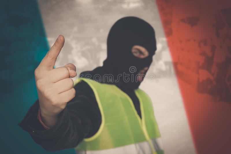 Concept of street protests of workers, proletarians against system, bourgeoisie. Yellow vests protest against higher fuel prices. Yellow vests protest against royalty free stock photography