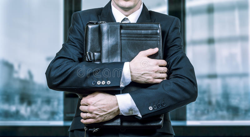 Concept of a stressed businessman under pressure. Fear of job loss stock photos