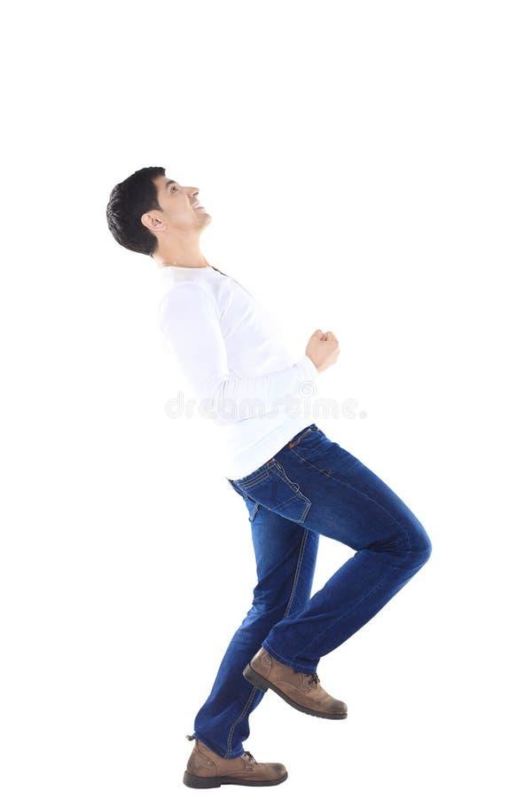 Concept succes in zaken: een zegevierend zakenman danst op witte achtergrond royalty-vrije stock foto
