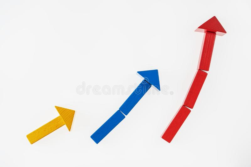The concept of success. Business graph. Growth progress concept with arrows. Growing graph of wooden blocks royalty free stock photo