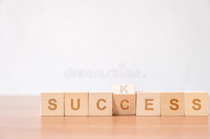 Suck to success concept for improvement to successfully. Concept of successful in business. flip changing letter on wood block from suck to success concept for stock photos