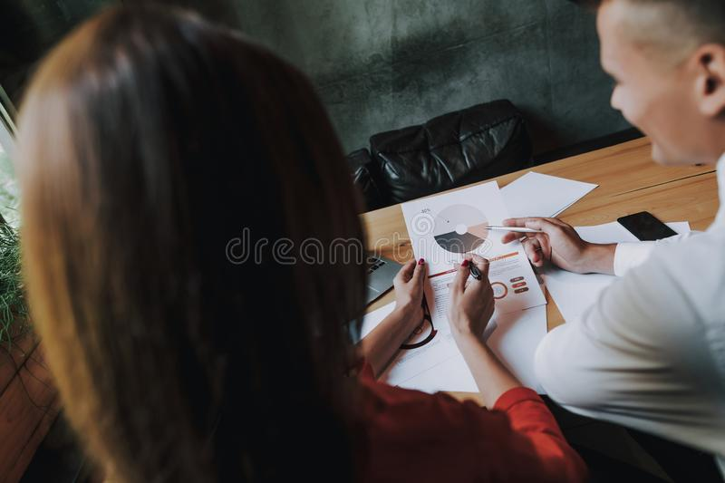 Back side man and woman working on project royalty free stock photo
