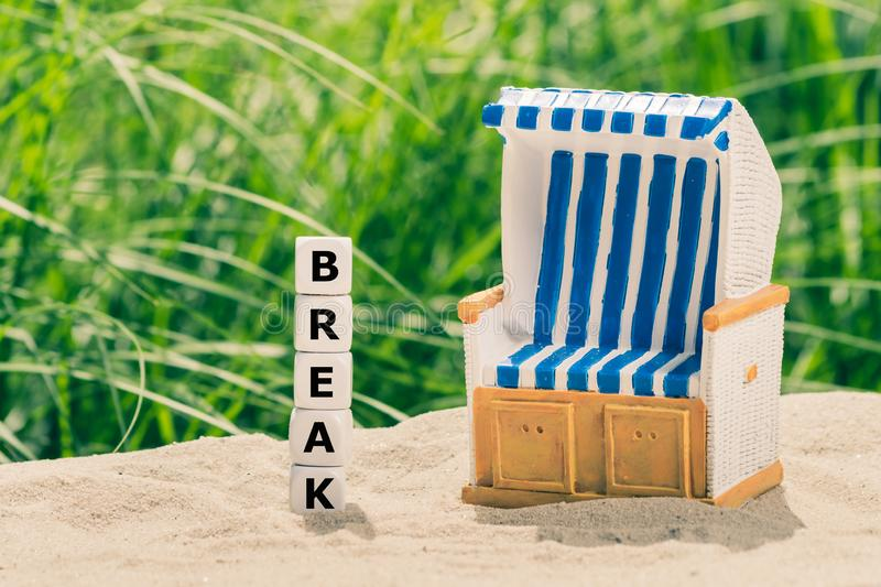 Concept for the summer break. Dice form the word `break` stock photography