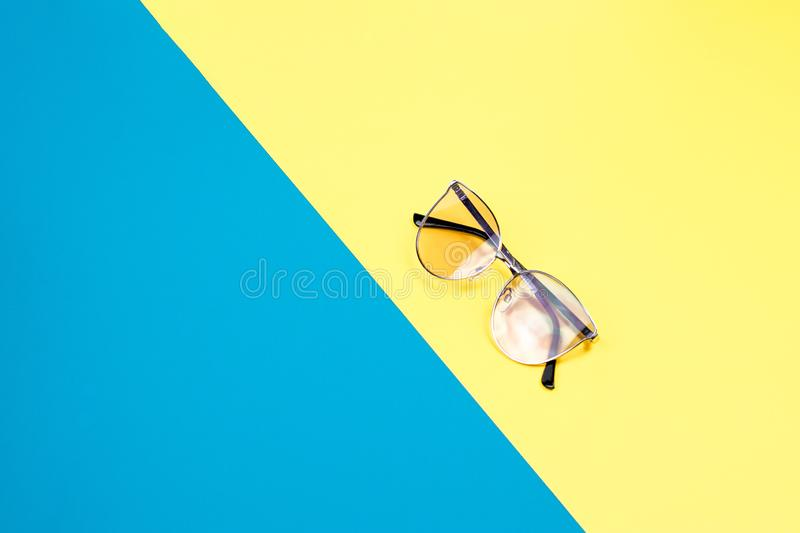 The concept of summer vacation. Top view on a sunglasses royalty free stock photos