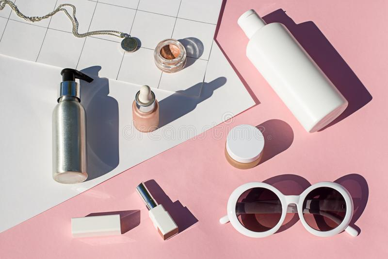 Concept suncreen Summer pink cosmetics flat lay . Top view. Beauty composition royalty free stock photo