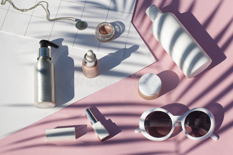 Concept suncreen Summer pink cosmetics flat lay . Top view royalty free stock photos