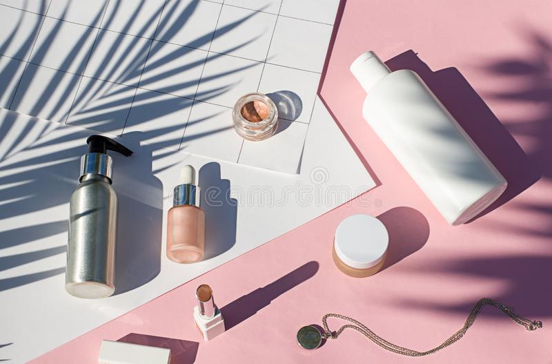 Concept suncreen Summer pink cosmetics flat lay . Top view. Beauty composition royalty free stock image