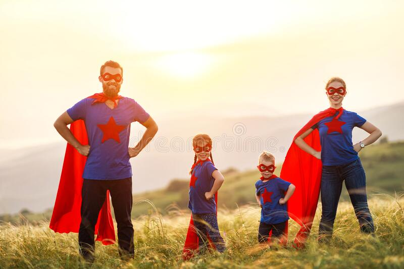 Concept of super family, family of superheroes at sunset stock images