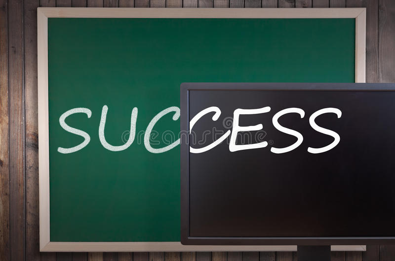 Concept - symbolizes success and progress. The word Success written on blackboard and PC screen symbolizes the progress in technology - concept stock images