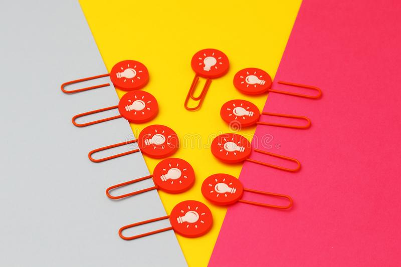 Paper clips concept symbolizing conflict of interest and different ideas. The concept symbolizing collisions and conflicts when the team has different point of stock photography