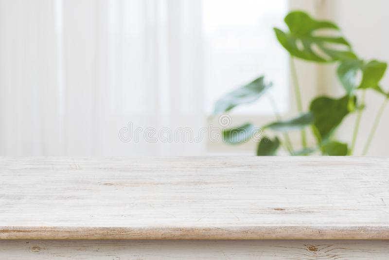Concept of table for product display over defocused window background.  stock photo