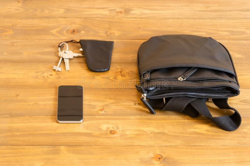 Concept on the table, things to take on the street, a bag, phone and keys stock images