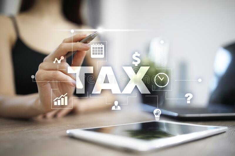 Concept of TAX paid by individuals and corporations. VAT. Income and wealth tax. stock image