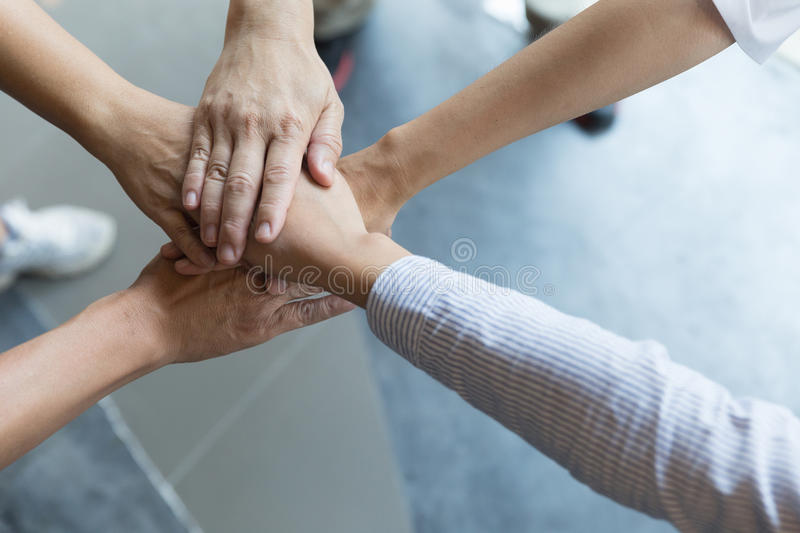 Concept of teamwork. business people joined hands royalty free stock photography