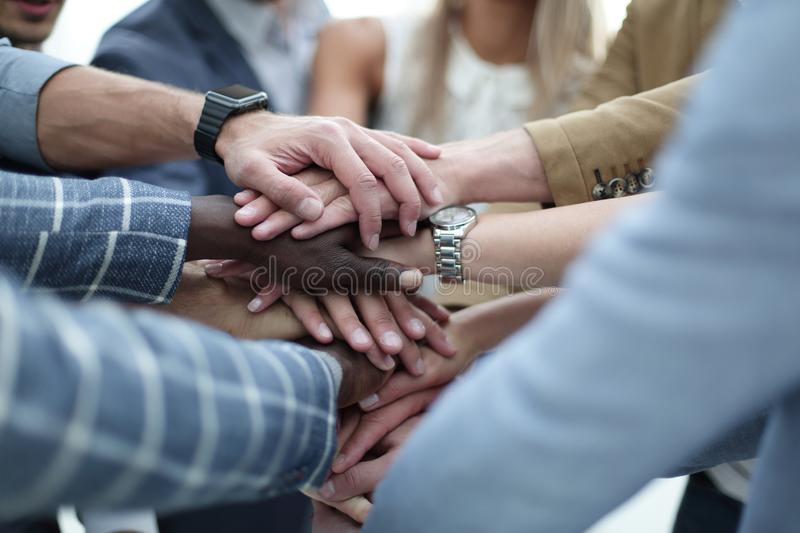 Close-Up of hands business team showing unity with putting their hands together stock photo