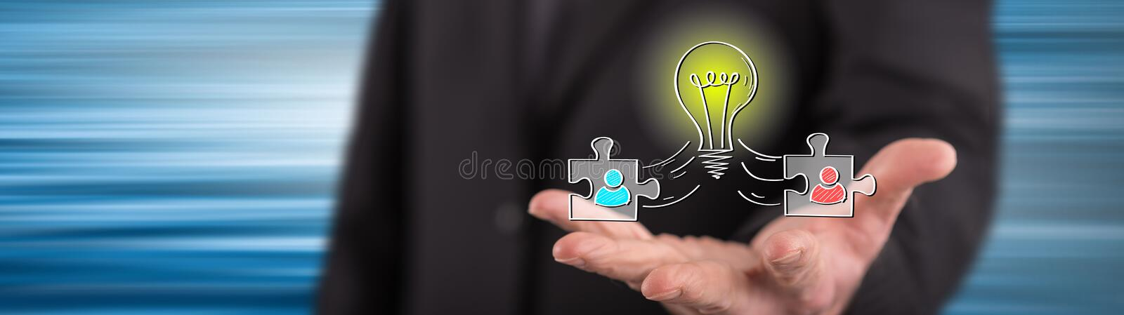 Concept of teamwork idea. Teamwork idea concept above the hand of a man in background stock photo
