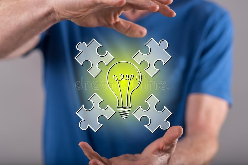 Concept of teamwork idea. Teamwork idea concept between hands of a man in background royalty free stock image