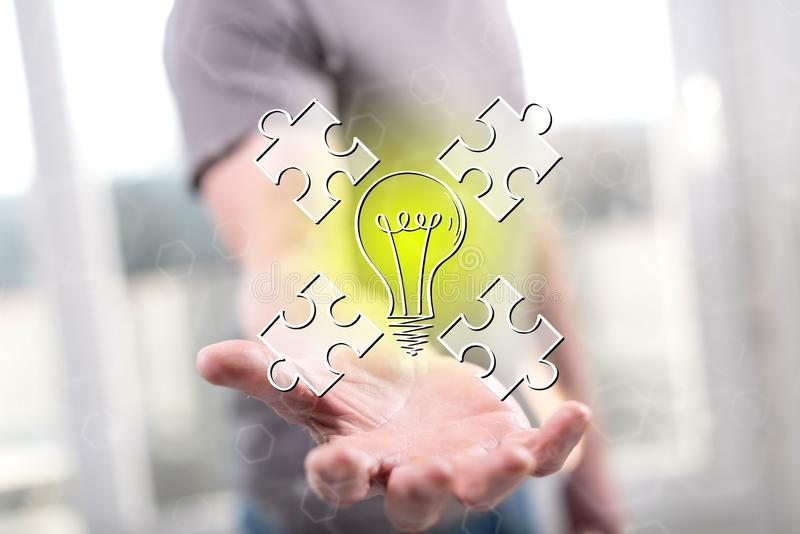 Concept of teamwork idea. Teamwork idea concept above the hand of a man in background royalty free stock photo