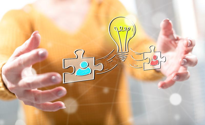 Concept of teamwork idea. Teamwork idea concept between hands of a woman in background royalty free stock photo