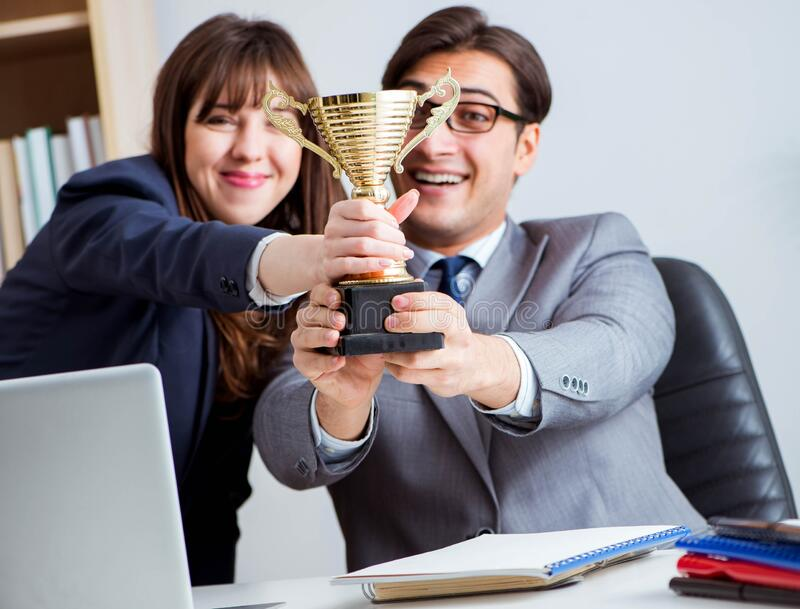 Concept of teamwork with prize. The concept of teamwork with prize stock photography